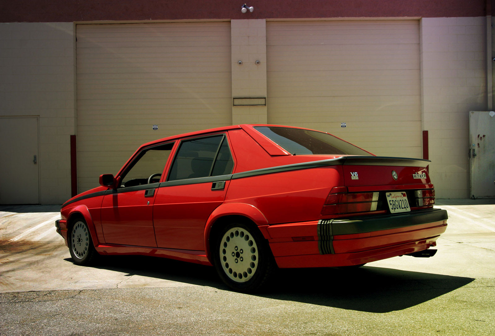 What's So Lovable About The Alfa Romeo 75? • Petrolicious