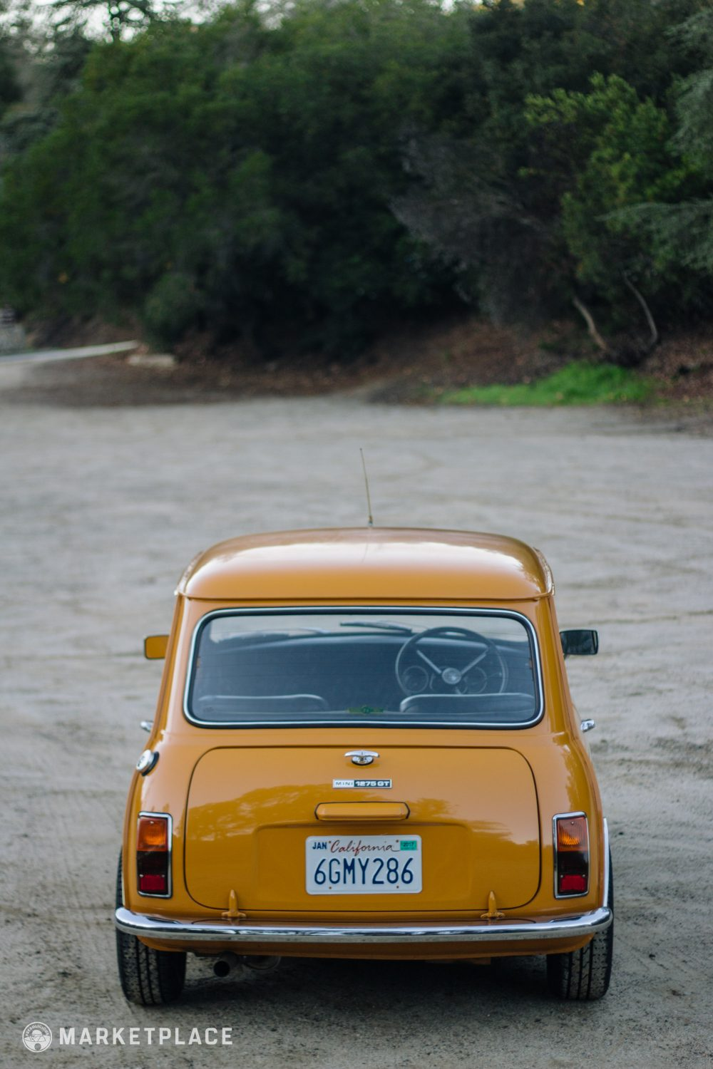 "Paint – The Bronze Yellow factory color respray is nearly flawless with  great shine and is finished with the proper ""Mini 1275 GT"" side graphics."