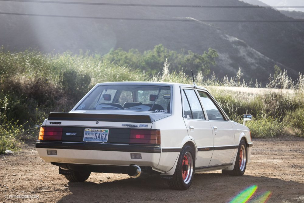 Period correct mitsubishi lancer box type embraces vintage and if the lancer were any other color but the milky off white its been painted the red would be an eyesore instead of the complement that it is on asfbconference2016 Gallery