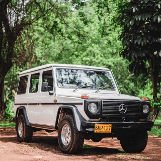 A Mercedes Station Wagon, G-Wagen, And A BMW Pickup Truck Share A Garage In Colombia