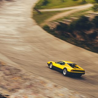 Breathing Life Back Into A Forgotten Spanish Racetrack With A Fly Yellow Ferrari 512 BB
