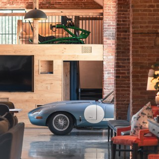 Cat In The Clubhouse: This Modified FIA-Racer Jaguar E-Type Is Perfectly At Home In This Converted Countryside Barn